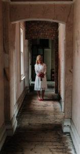 Portrait of bride standing in hallway at Victoria Baths in Manchester