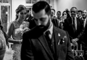 black and white photograph of bride walking up the aisle at the Bluecoat in Liverpool