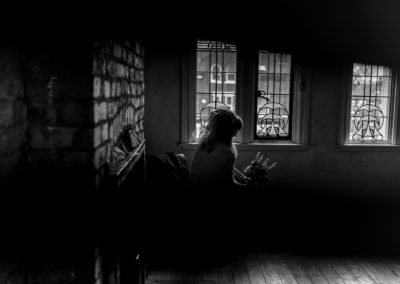 silhouette of bride sitting on chair at Victoria Baths in Manchester