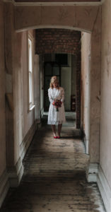 Portrait of bride standing in hallway at Victoria Baths in Manchester