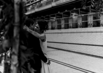 black and white photograph of bride about to kiss her groom at Victoria Baths in Manchester