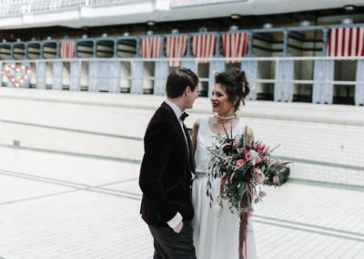 bride holding bouquet gazes into her grooms eyes at Victoria Baths in Manchester