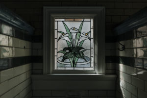 decorative stained glass window at victoria baths in manchester
