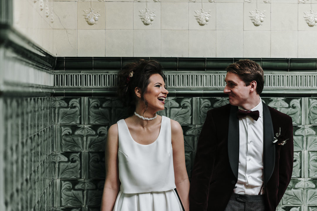 documentary photograph of a laughing bride and groom at Victoria Baths in Manchester